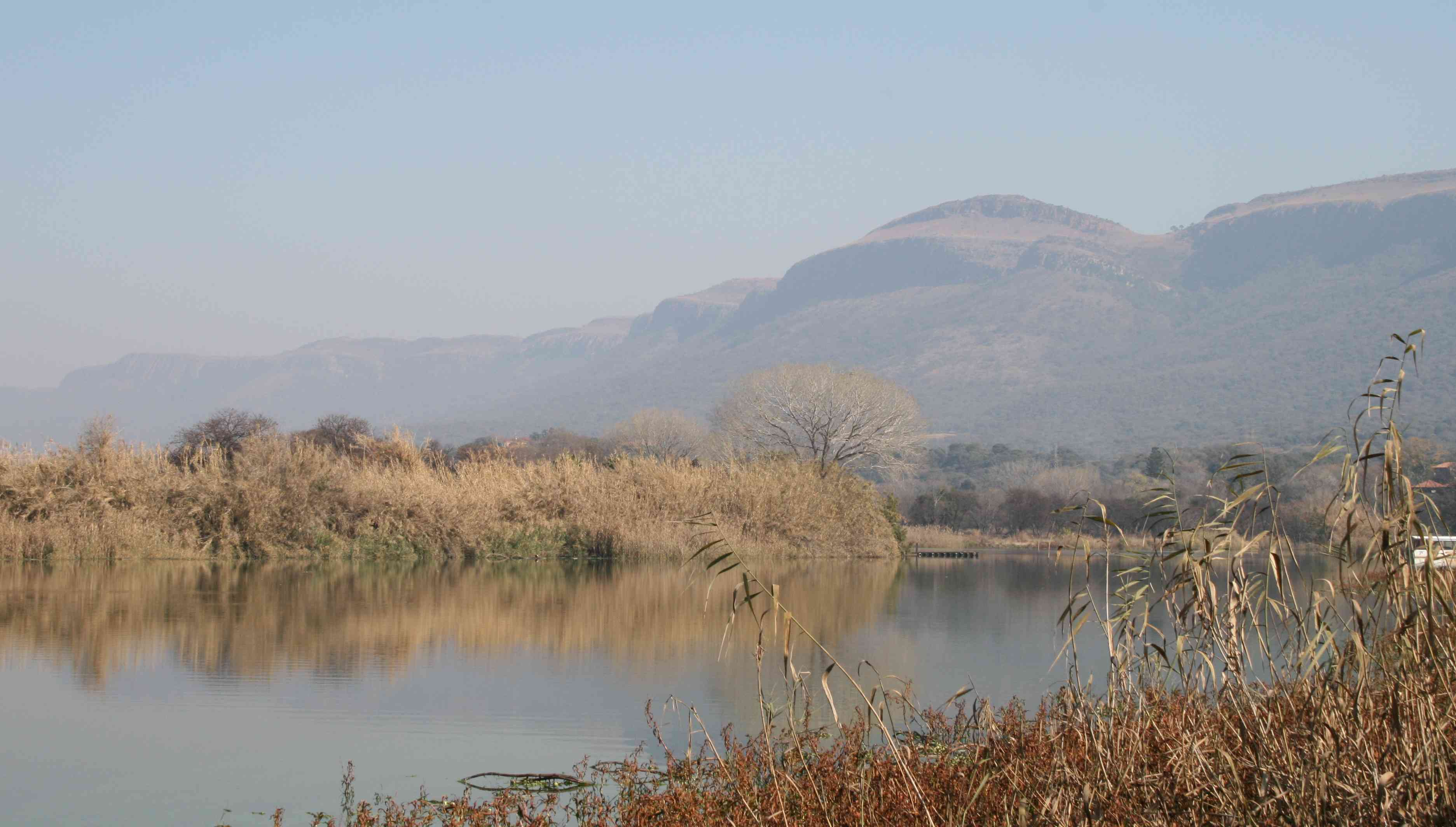 A tranquil part of the dam overlooked by the Magaliesberg